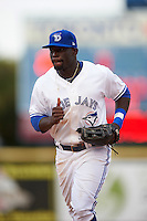 Dunedin Blue Jays outfielder Anthony Alford (10) jogs to the dugout during the first game of a doubleheader against the Palm Beach Cardinals on July 31, 2015 at Florida Auto Exchange Stadium in Dunedin, Florida.  Dunedin defeated Palm Beach 7-0.  (Mike Janes/Four Seam Images)