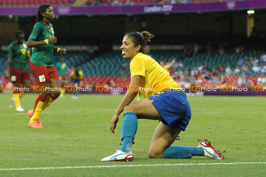 CRISTIANE of Brazil celebrates scoring the fourth goal - Brazil Women vs Cameroon Women - Womens Olympic Football Tournament London 2012 Group E at the Millenium Stadium, Cardiff, Wales - 25/07/12 - MANDATORY CREDIT: Gavin Ellis/SHEKICKS/TGSPHOTO - Self billing applies where appropriate - 0845 094 6026 - contact@tgsphoto.co.uk - NO UNPAID USE.