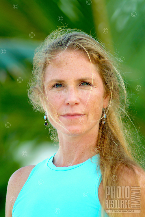 Portrait of a female yoga instructor ( age 40's)  in an outdoor beach setting