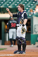 Louisville catcher Ryan Jorgensen (8) lets the defense know there are 2 outs versus Indianapolis at Louisville Bats Field in Louisville, KY, Wednesday, August 8, 2007.