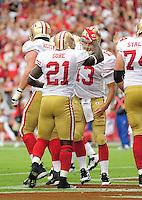 Sept. 13, 2009; Glendale, AZ, USA; San Francisco 49ers running back (21) Frank Gore is congratulated by quarterback (13) Shaun Hill after scoring a touchdown against the Arizona Cardinals at University of Phoenix Stadium. San Francisco defeated Arizona 20-16. Mandatory Credit: Mark J. Rebilas-