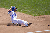 Florida Gators second baseman Dalton Guthrie (5) slides into third base against the Virginia Cavaliers in Game 11 of the NCAA College World Series on June 19, 2015 at TD Ameritrade Park in Omaha, Nebraska. The Gators defeated Virginia 10-5. (Andrew Woolley/Four Seam Images)