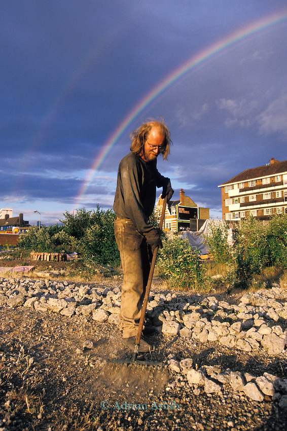 Rainbow George  tending to the stone spiral on the site of the Wandsworth Eco village.