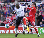 Middlesbrough's Tuncay Sanli and Derby's Darren Moore. during the Premier League match at the Riverside Stadium, Middlesbrough. Picture date 8th March 2008. Picture credit should read: Richard Lee/Sportimage