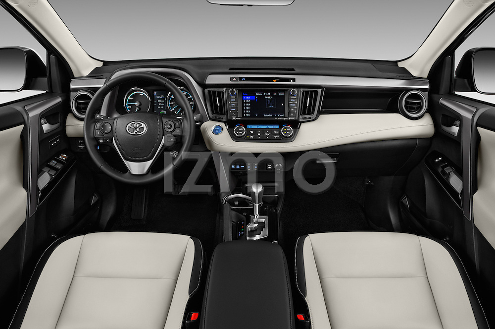 Stock photo of straight dashboard view of 2016 Toyota RAV4 Hybrid-Limited-4x4 5 Door SUV Dashboard