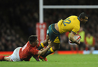Australia's Kurtley Beale is tackled by Wales' Josh Adams<br /> <br /> Photographer Ian Cook/CameraSport<br /> <br /> Under Armour Series Autumn Internationals - Wales v Australia - Saturday 10th November 2018 - Principality Stadium - Cardiff<br /> <br /> World Copyright © 2018 CameraSport. All rights reserved. 43 Linden Ave. Countesthorpe. Leicester. England. LE8 5PG - Tel: +44 (0) 116 277 4147 - admin@camerasport.com - www.camerasport.com