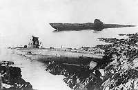 A most remarkable post-war incident was the washing up on the rocks at Falmouth, England, of two German U-boats.  They were cast up but a few feet apart; both had been sunk during the war.  1921.  INP.  (OWI)<br /> Exact Date Shot Unknown<br /> NARA FILE #:  208-PR-10K-1<br /> WAR & CONFLICT BOOK #:  709
