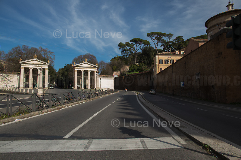 """Villa Borghese.<br /> <br /> Rome, 12/03/2020. Documenting Rome under the Italian Government lockdown for the Outbreak of the Coronavirus (SARS-CoV-2 - COVID-19) in Italy. On the evening of the 11 March 2020, the Italian Prime Minister, Giuseppe Conte, signed the March 11th Decree Law """"Step 4 Consolidation of 1 single Protection Zone for the entire national territory"""" (1.). The further urgent measures were taken """"in order to counter and contain the spread of the COVID-19 virus"""" on the same day when the WHO (World Health Organization, OMS in Italian) declared the coronavirus COVID-19 as a pandemic (2.).<br /> ISTAT (Italian Institute of Statistics) estimates that in Italy there are 50,724 homeless people. In Rome, around 20,000 people in fragile condition have asked for support. Moreover, there are 40,000 people who live in a state of housing emergency in Rome's municipality.<br /> March 11th Decree Law (1.): «[…] Retail commercial activities are suspended, with the exception of the food and basic necessities activities […] Newsagents, tobacconists, pharmacies and parapharmacies remain open. In any case, the interpersonal safety distance of one meter must be guaranteed. The activities of catering services (including bars, pubs, restaurants, ice cream shops, patisseries) are suspended […] Banking, financial and insurance services as well as the agricultural, livestock and agri-food processing sector, including the supply chains that supply goods and services, are guaranteed, […] The President of the Region can arrange the programming of the service provided by local public transport companies […]».<br /> Updates: on the 12.03.20 (6:00PM) in Italy there 14.955 positive cases; 1,439 patients have recovered; 1,266 died.<br /> <br /> Footnotes & Links:<br /> Info about COVID-19 in Italy: http://bit.do/fzRVu (ITA) - http://bit.do/fzRV5 (ENG)<br /> 1. March 11th Decree Law http://bit.do/fzREX (ITA) - http://bit.do/fzRFz (ENG)<br /> 2. http://bit.do/fzRKm"""