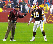 Washington Redskins head coach Marty Schottenheimer gives some instructions to Redskin quarterback Kent Graham (10) in the last drive where the Redskins ran out the clock against the Arizona Cardinals in Landover, Maryland on January 6, 2002.  The Redskins won the game 20 - 17 to secure their 8th victory of the season 20-17.<br /> Credit: Arnie Sachs / CNP