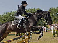 Russia's Yuliya Kolegova falls from the horse called Passziansz (means Solitaire in Hungarian) during the Modern Pentathlon Women's World Cup held in Budapest, Hungary on May 07, 2011. ATTILA VOLGYI