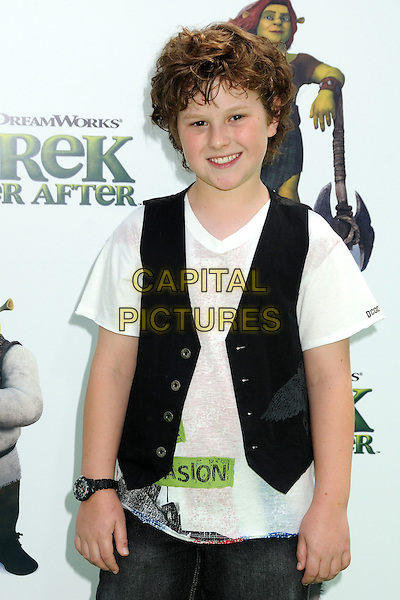 "NOLAN GOULD.""Shrek Forever After"" Los Angeles Premiere held at the Gibson Amphitheatre, Universal City, California, USA..May 16th, 2010.half length white top black waistcoat.CAP/ADM/BP.©Byron Purvis/AdMedia/Capital Pictures."