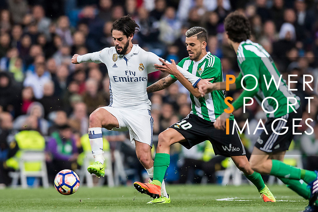 Isco Alarcon (l) of Real Madrid competes for the ball with Daniel Ceballos Fernandez, Dani Ceballos, of Real Betis during their La Liga match between Real Madrid and Real Betis at the Santiago Bernabeu Stadium on 12 March 2017 in Madrid, Spain. Photo by Diego Gonzalez Souto / Power Sport Images