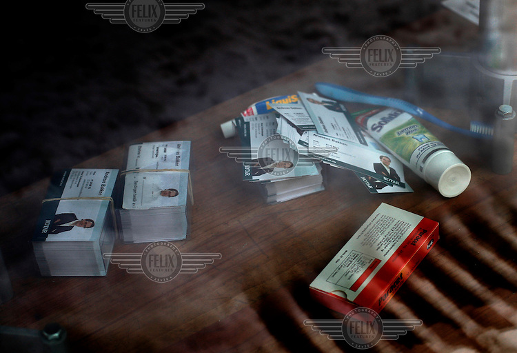 Business cards, Paracetamol, toothbrush and toothpaste lies in a windowsill in an otherwise empty office of a bankrupt real estate agent.  More than 100 offices were closed in Norway as a result of the financial crisis.