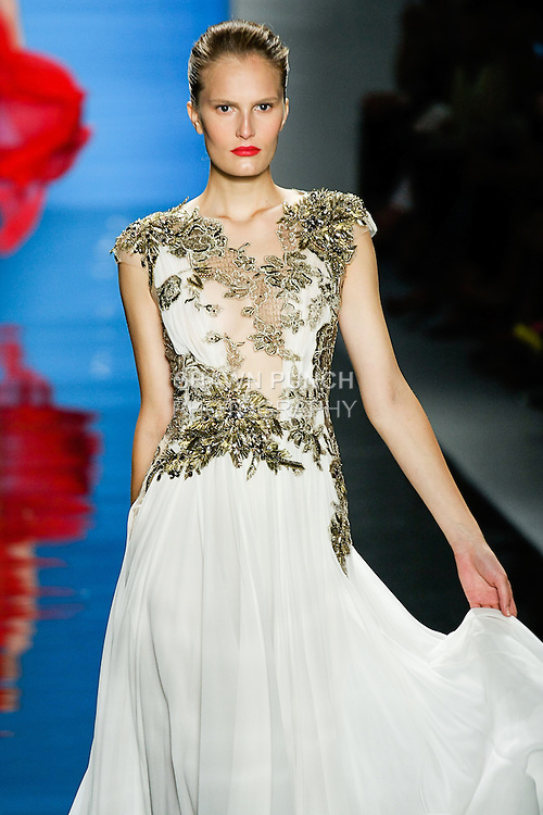 Alla walks runway in an outfit from the Reem Acra Spring 2013 ready-to-wear collection, during Merecedes-Benz Fashion Week Spring 2013 in New York City.