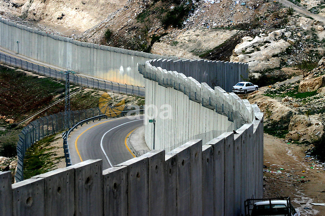 A view shows a section of Israel's controversial concrete barrier that separates the West Bank from Jerusalem on Jan.18, 2012. in Abu Dis, in Israeli-annexed east Jerusalem. Photo by Mahfouz Abu Turk