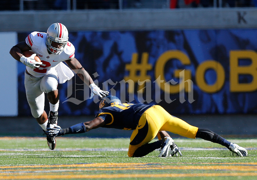 Ohio State Buckeyes running back Jordan Hall (2) dodges a tackle from California Golden Bears cornerback Cameron Walker (14) in the second quarter of the NCAA football game at Memorial Stadium in Berkeley, California,  Saturday afternoon, September 14, 2013. The Ohio State Buckeyes defeated the California Golden Bears 52 - 34. (The Columbus Dispatch / Eamon Queeney)