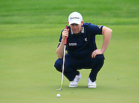 Stephen Gallacher (SCO) on the 1st green during Thursday's Round 1 of the 2014 BMW Masters held at Lake Malaren, Shanghai, China 30th October 2014.<br /> Picture: Eoin Clarke www.golffile.ie