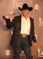LAS VEGAS, NV - April 6: Entertainer of the Year Award winner George Strait at the 49th Annual Academy of Country Music Awards Press Room at the MGM Grand on April 6, 2014 in Las Vegas, Nevada. © Kabik/ Starlitepics