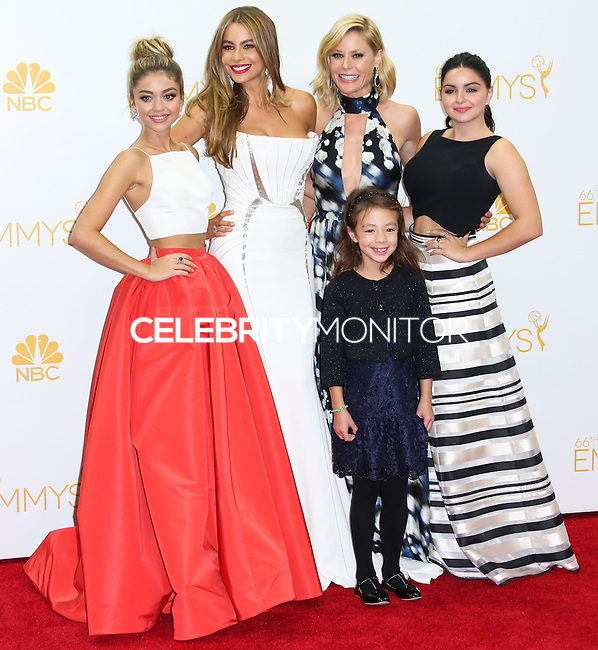 LOS ANGELES, CA, USA - AUGUST 25: Actresses Sarah Hyland, Sofia Vergara, Aubrey Anderson-Emmons, Julie Bowen and Ariel Winter, winners of the Outstanding Comedy Series Award for 'Modern Family' pose in the press room at the 66th Annual Primetime Emmy Awards held at Nokia Theatre L.A. Live on August 25, 2014 in Los Angeles, California, United States. (Photo by Celebrity Monitor)