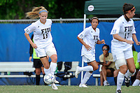 2 October 2011:  FIU midfielder/forward Nicole DiPerna (16) moves the ball as teammate midfielder/forward Kim Lopez (7) looks on in the second half as the FIU Golden Panthers defeated the University of South Alabama Jaguars, 2-0, at University Park Stadium in Miami, Florida.
