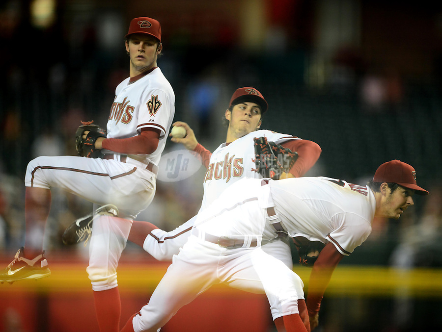 Jul. 3, 2012; Phoenix, AZ, USA: (Editors note: Multiple exposure photograph) Arizona Diamondbacks pitcher Trevor Bauer throws in the first inning against the San Diego Padres at Chase Field. Mandatory Credit: Mark J. Rebilas-