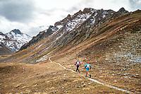 Running through a wide open landscape during the Via Valais, a multi-day trail running tour connecting Verbier with Zermatt, Switzerland.