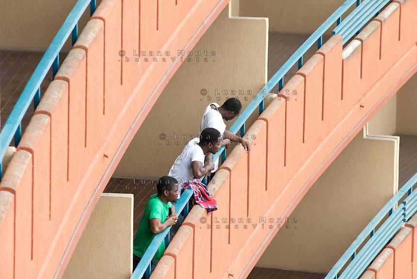 Profughi provenienti dalla Libia, alloggiati al residence Ripamonti. Pieve Emanuele (Milano), 26 maggio 2011...Fugitives from Libya, lodged in Ripamonti Residence. Pieve Emanuele (Milan), May 26, 2011