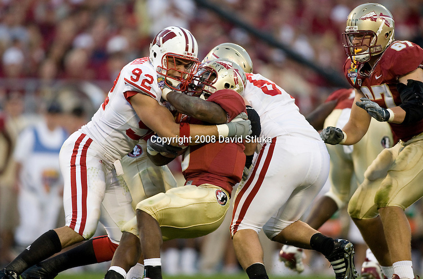 ORLANDO, FL - DECEMBER 27: Defensive linemen Matt Shaughnessy #92 and Mike Newkirk #54 of the Florida State Seminoles of the Wisconsin Badgers tackle running back Antone Smith #6 of the Florida State Seminoles during the Champs Sports Bowl on December 27, 2008 at the Citrus Bowl in Orlando, Florida. Florido State beat Wisconsin 42-13. (Photo by David Stluka)