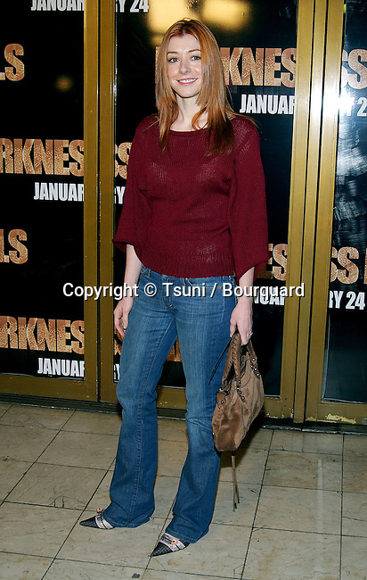 "Alyson Hannigan arriving at the premiere of ""Darkness Falls"" at the Mann National Theatre in Los Angeles. January 22, 2003."