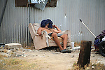 HOMELESS MAN SLEEPS in DISCARDED CHAIR (1)