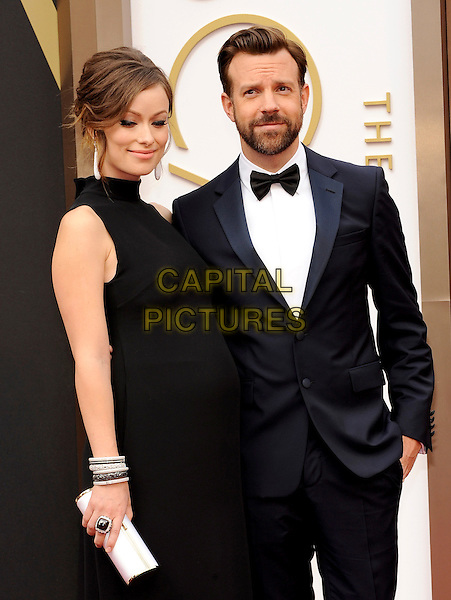HOLLYWOOD, CA - MARCH 2: Olivia Wilde, Jason Sudeikis arriving to the 2014 Oscars at the Hollywood and Highland Center in Hollywood, California. March 2, 2014.  <br /> CAP/MPI/mpi99<br /> &copy;mpi99/MediaPunch/Capital Pictures