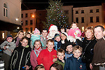 Santa with a group of his biggest fans at the switching on of the Christmas lights on West Street, last Friday.
