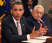 United States President Barack Obama makes a statement during a meeting with present administration officials and former Secrtaries of State and Defense in the Roosevelt Room of the White House on Thursday, November 18, 2010.   From left to right: President Obama; and Henry Kissinger, former Secretary of State..Credit: Dennis Brack / Pool via CNP