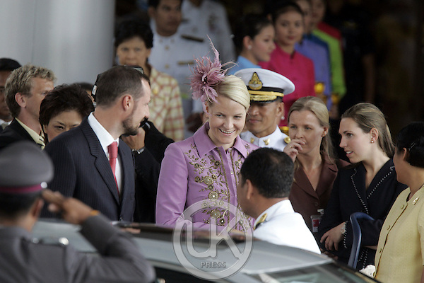 Crown Prince Haakon & Crown Princess Mette-Marit of Norway arrive at Don Muang Airport with their son Prince Sverre Magnus to attend the celebrations to mark the 60th anniversary of Thai King Bhumibol Adulyadej's accession to the throne. They were met by Princess Maya Chakri Sirindhorn of Thailand..