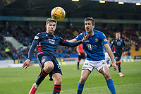 29th December 2019; McDairmid Park, Perth, Perth and Kinross, Scotland; Scottish Premiership Football, St Johnstone versus Ross County; Blair Spittal of Ross County challenges for the ball with Callum Booth of St Johnstone  - Editorial Use