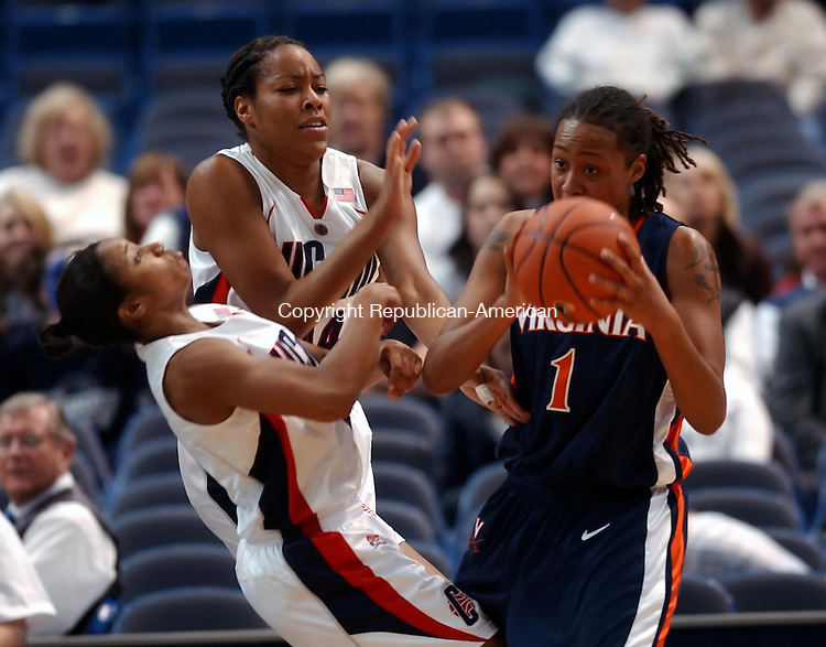 HARTFORD --05 DECEMBER 2007-120507JS04-Virginia's Lyndra Little (1) is called for an offensive foul after running into UConn's Ketia Seanier (11)<br /> during their game Monday at the Hartford Civic Center. Also defending on the play was Brittany Hunter (44).<br />  Jim Shannon/Republican-American