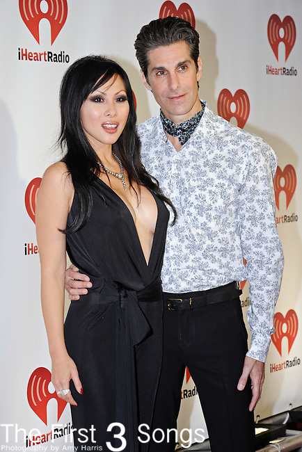 Perry Farrell of Jane's Addiction with wife Etty Lau Farrell at the 2011 iHeartRadio Music Festival on September 23, 2011 at the MGM Garden Arena in Las Vegas, Nevada.