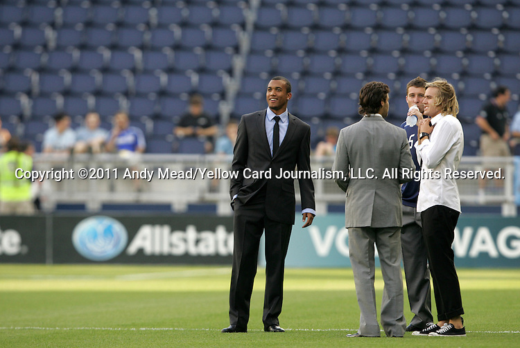 09 June 2011: Sporting players walk around the field before the game. From left Teal Bunbury, Graham Zusi, Matt Besler, and Chance Myers. Sporting Kansas City played the Chicago Fire to a 0-0 tie in the inaugural game at LIVESTRONG Sporting Park in Kansas City, Kansas in a 2011 regular season Major League Soccer game.