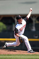 Rochester Red Wings relief pitcher Dusty Hughes #4 delivers a pitch during a game against the Norfolk Tides at Frontier Field on June 5, 2011 in Rochester, New York.  Norfolk defeated Rochester 11-5 in eleven innings.  Photo By Mike Janes/Four Seam Images