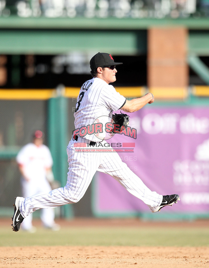 Thomas Field makes the first of two very good defensive players in the 8th inning to help preserve the lead for the Scottsdale Scorpions, who defeated the Peoria Javelinas, 3-2, to win the Arizona Fall League championship at Scottsdale Stadium, Scottsdale, AZ - 11/20/2010.Photo by:  Bill Mitchell/Four Seam Images..