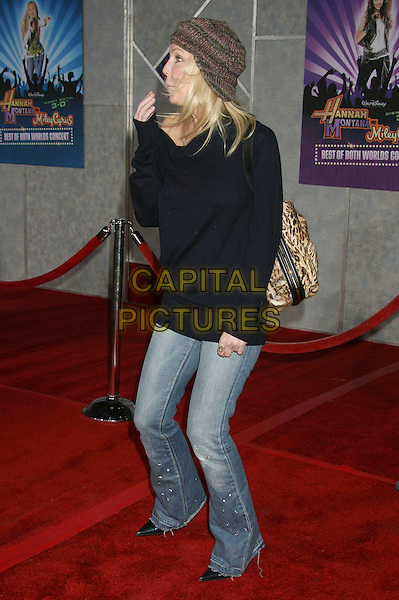 "HEATHER LOCKLEAR .Disney's """"Hannah Montana & Miley Cyrus: Best Of Both Worlds"" World Premiere held at the El Capitan Theatre, Hollywood, California, .USA,1 7 January 2008..full length black top jeans knitted cap hat funny bag.CAP/ADM/RE.©Russ Elliot/AdMedia/Capital Pictures. *** Local Caption *** ."