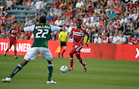 Chicago forward Patrick Nyarko (14) dribbles into space while Portland defender Rodney Wallace (22) awaits.  The Portland Timbers defeated the Chicago Fire 1-0 at Toyota Park in Bridgeview, IL on July 16, 2011.