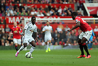 Pictured L-R: Nathan Dyer of Swansea against Tyler Blackett of Manchester United. Saturday 16 August 2014<br />