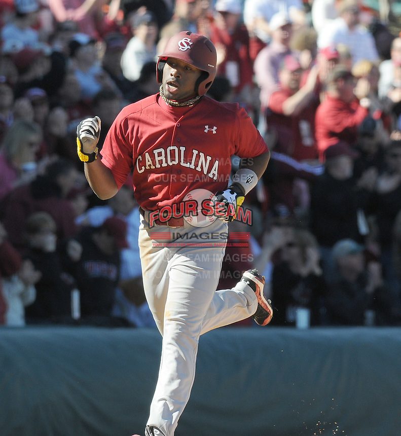 USC center fielder Jackie Bradley Jr. (19) pumps his fist heading home after hitting a home run during a game between the Clemson Tigers and South Carolina Gamecocks Saturday, March 6, 2010, at Fluor Field at the West End in Greenville, S.C. Photo by: Tom Priddy/Four Seam Images