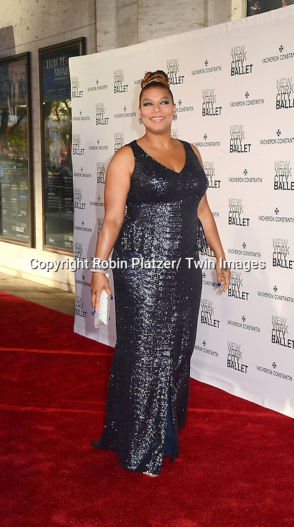 Queen Latifah in Carmen Marc Valvo attends the New York City Ballet Spring 2013  Gala on May 8, 2013 at The David H Koch Theater in LIncoln Center in New York City.