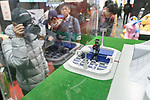 A visitor takes a picture of an action figure of Mazinger Z on display during the AnimeJapan 2017 at Tokyo Big Sight on March 25, 2017, Tokyo, Japan. AnimeJapan 2017 is a trade show promoting ''Everything Anime'' to local and foreign fans and businesses. The show is held over four-day days with March 23-24 reserved for business visitors and March 25-26 for the public. It is expected to attract some 120,000 visitors, including cosplayers. (Photo by Rodrigo Reyes Marin/AFLO)