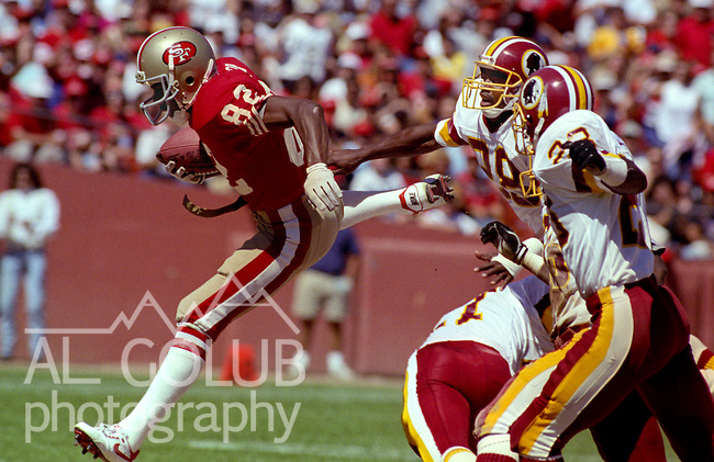San Francisco 49ers vs Washington Redskins at Candlestick Park Sunday, September 16, 1990..49ers beat Redskins 26-13.49er wide receiver John Taylor (82) jumps away from defenders...