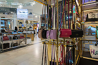 The Kate Spade boutique within Macy's department store in New York with the Coach boutique behind it on Monday, May 8, 2017.  Luxury leather goods retailer Coach has bought handbag and women's apparel retailer Kate Spade in a $2.4 billion deal.  (© Richard B. Levine)
