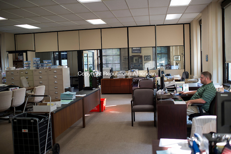 WATERBURY, CT - 1 September 2015-090115EC02-- Besides city employees, the Waterbury Registrars of Voters office sat empty Tuesday night during a public enrollment and registration session. Not one person came through the door during the first hour, employees say they didn't expect anyone since most voters register online at www.waterburyct.org. Erin Covey Republican-American.