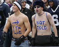 State College, PA - 11/27/2010:  Penn State students Troy Stram (left), from York, and Christopher Grassi (right), from Nazareth, PA, cheer on their team despite the 30° temperatures during the game.  Penn State lost to Michigan State by a score of 28-22 on Senior Day at Beaver Stadium...Photo:  Joe Rokita / JoeRokita.com..Photo ©2010 Joe Rokita Photography